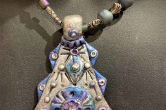 Polymer-with-mica-pendent-with-druzy-and-Tibetian-silver-beads-scaled